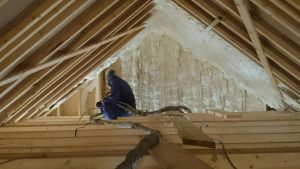 Insulation Contractor spraying foam in roof space